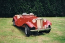 Another completely restored MG TD in the orchard.